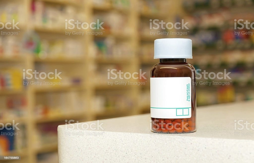 Medicine bottle with pills and a blank label stock photo