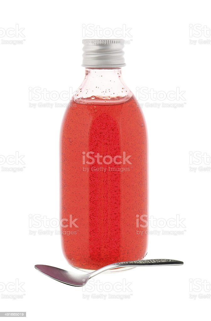 medicine bottle with red syrup and spoon isolated stock photo
