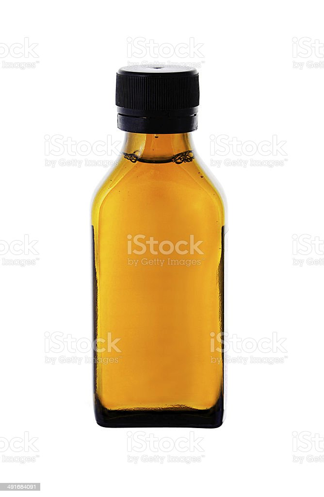 medicine bottle with yellow syrup isolated on white background stock photo