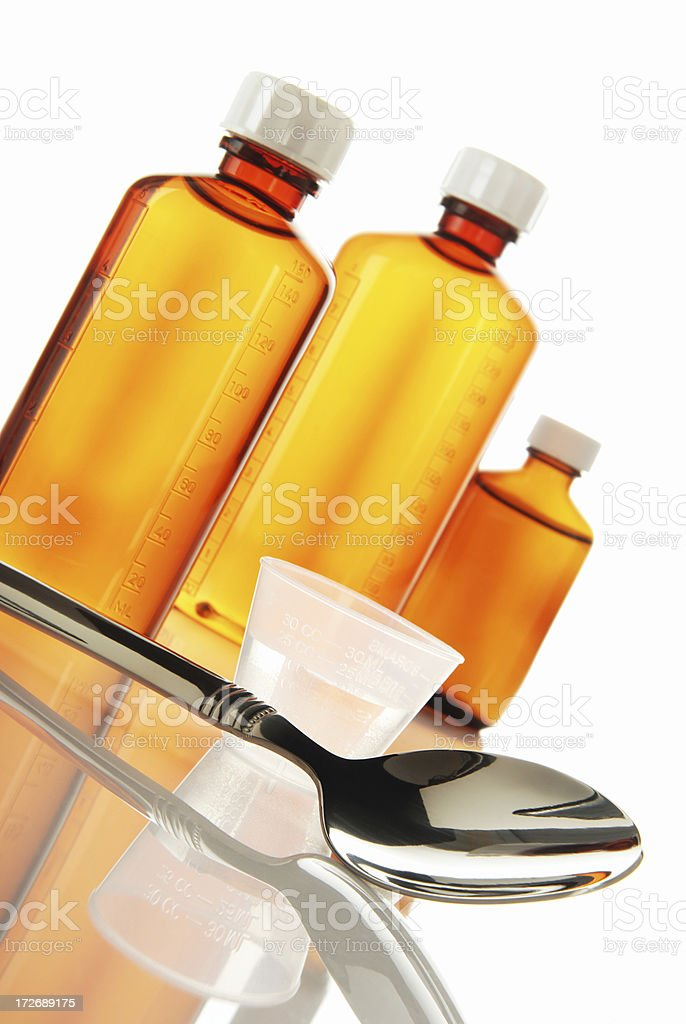 Medicine bottles and spoon royalty-free stock photo