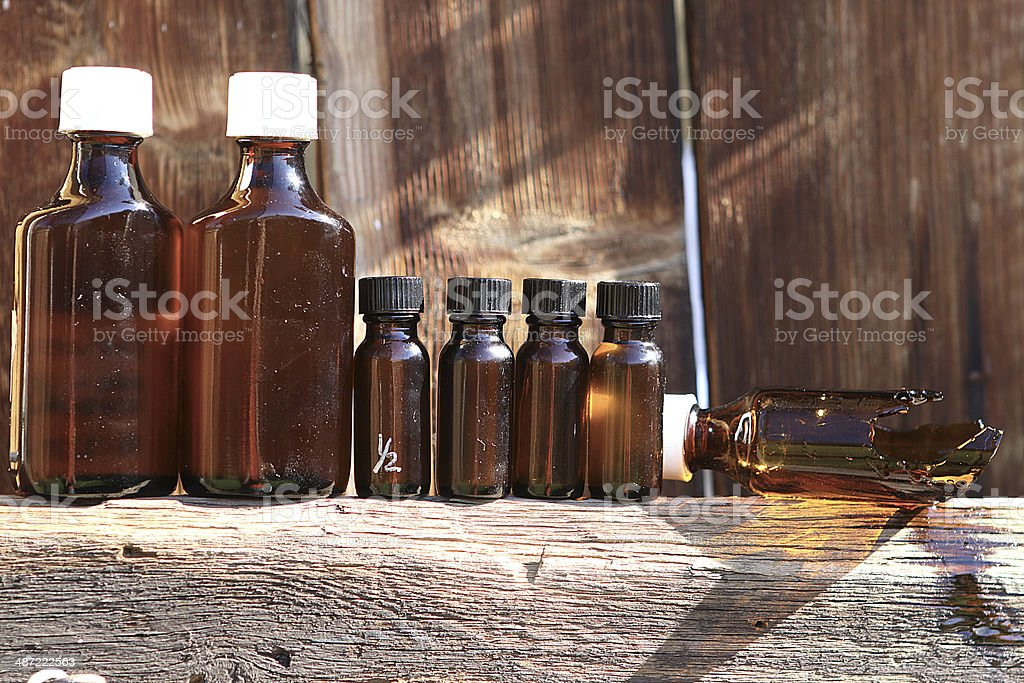 Medicine bottles on a wooden fence royalty-free stock photo
