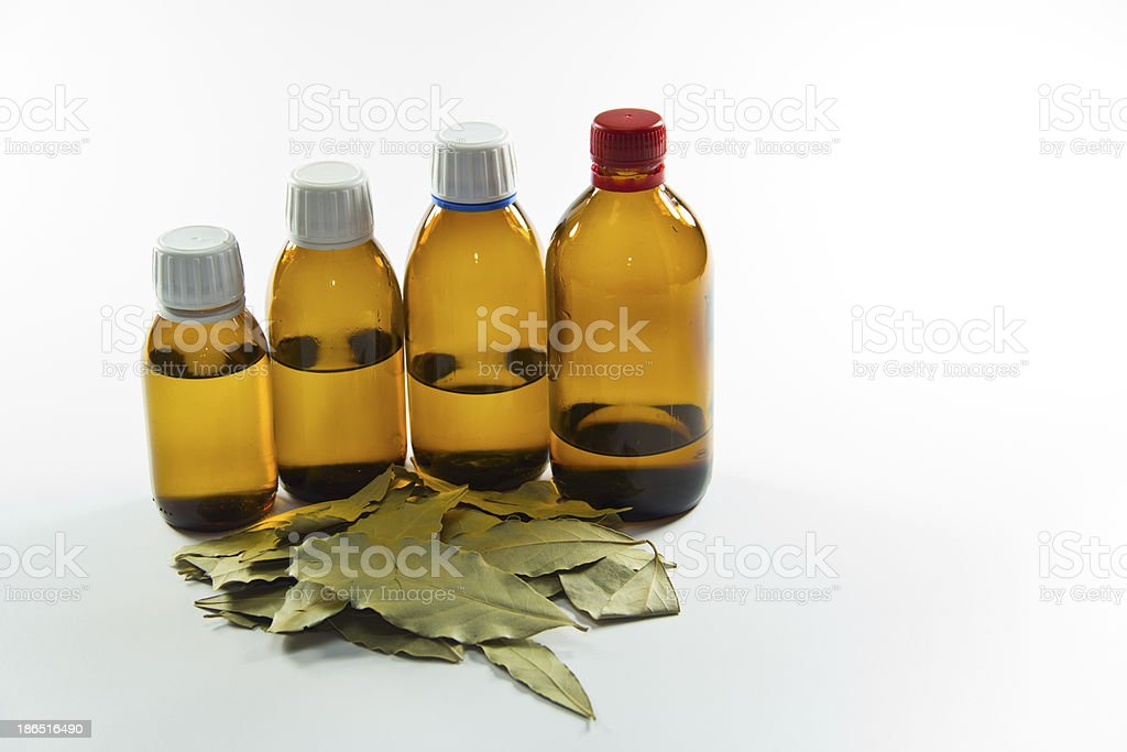 medicine bottle's with bay leaf on white background. stock photo