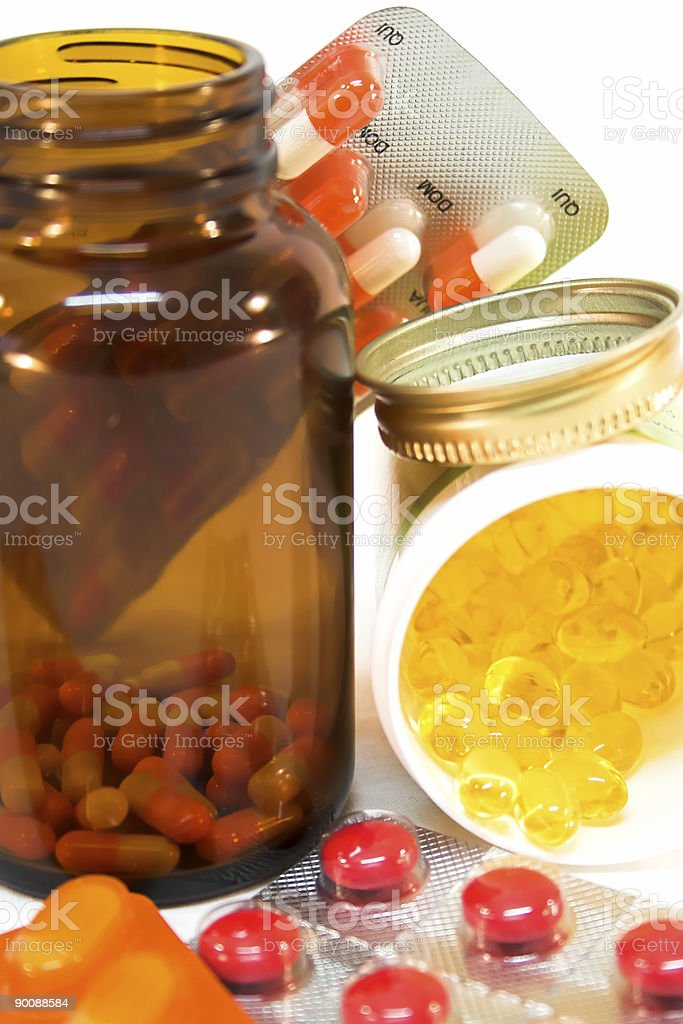 Medicine bottles with spilled pills. royalty-free stock photo