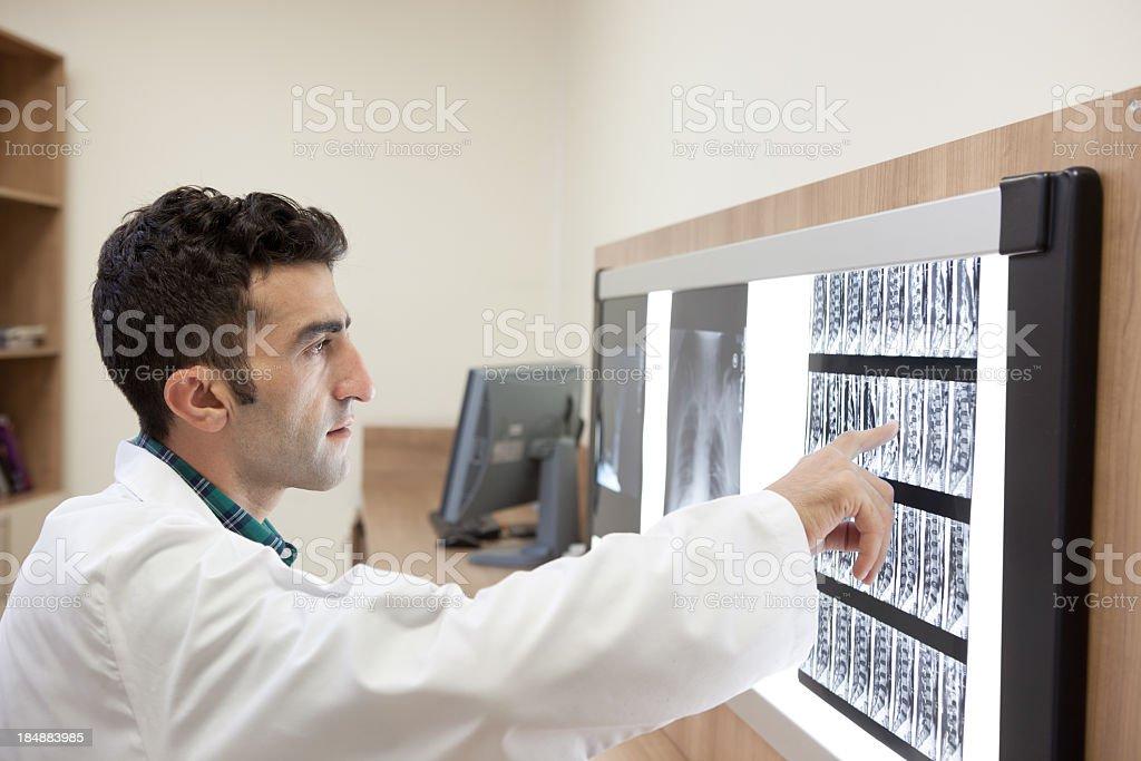 Medicine Doctor Examining MRI Scan On Light Box In Hospital royalty-free stock photo