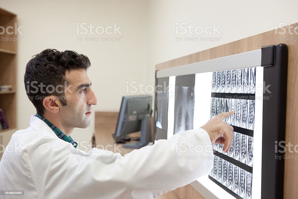 Medicine Doctor Examining MRI Scan On Light Box In Hospital stock photo