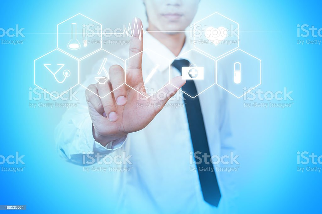 Medicine doctor hand working with modern computer interface as m stock photo