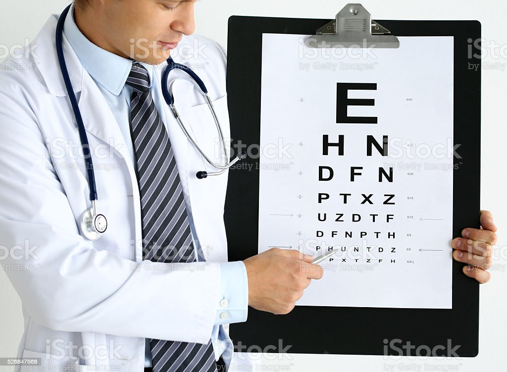 Medicine doctor hold big clipboard pad with eyesight check table stock photo