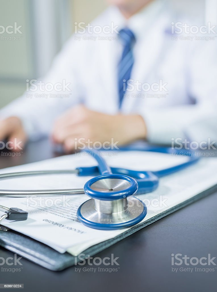 Medicine doctor's working table. Focus on stethoscope stock photo