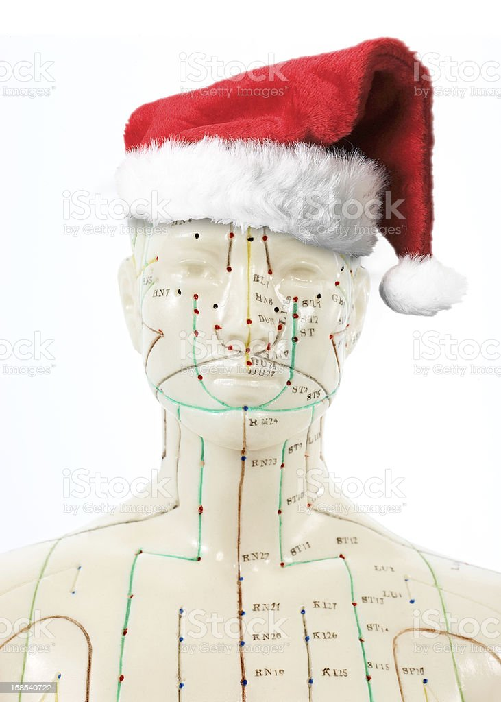 Medicine Doll with christmas hat befor white background.jpg royalty-free stock photo