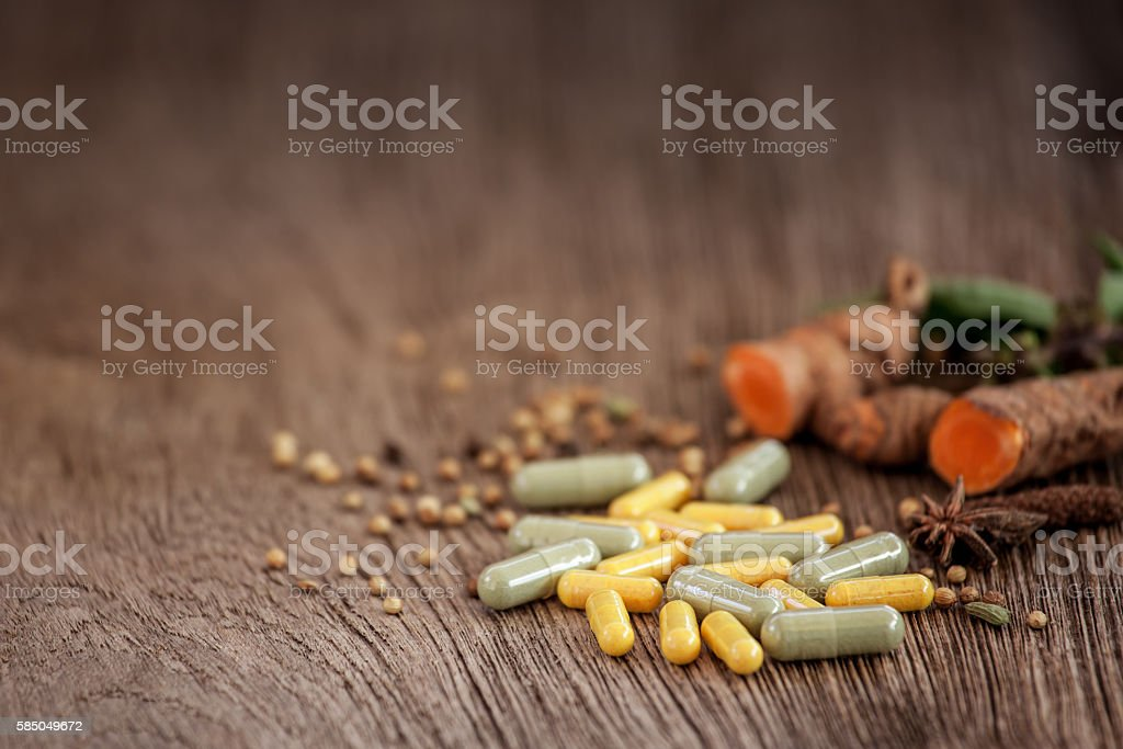 Medicine herb, Herbal capsule with healthy medicinal plant stock photo