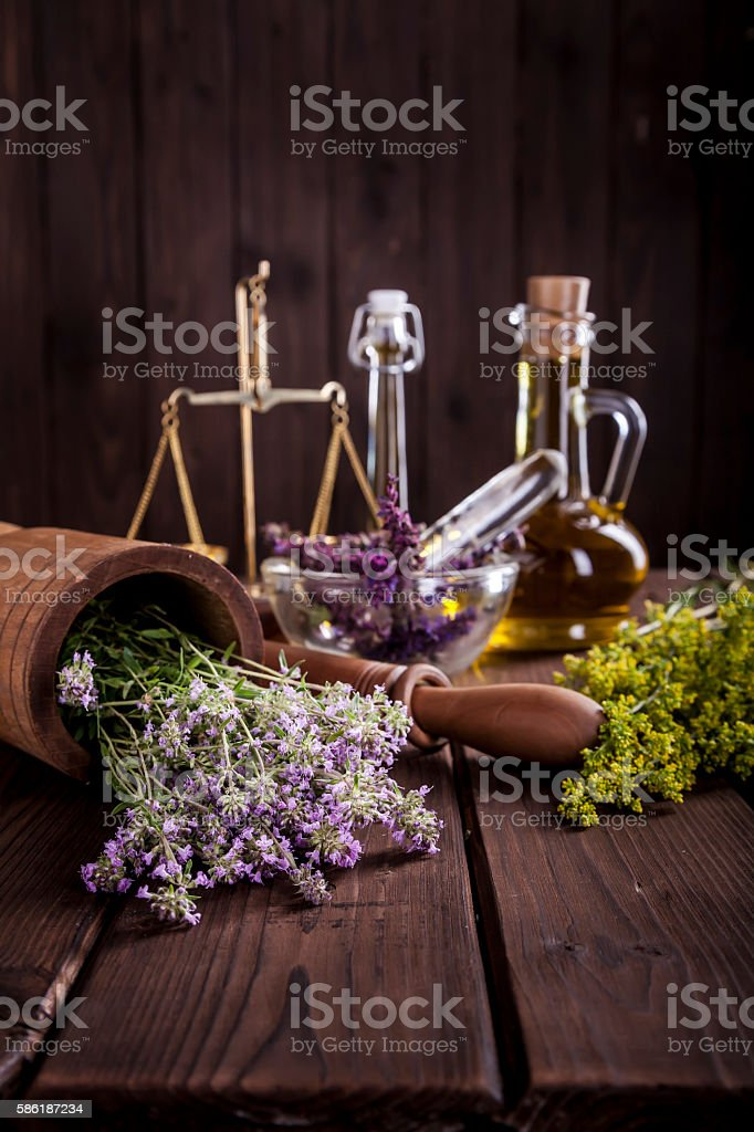 Medicine Herbs, Oil and  Balance Vertical stock photo