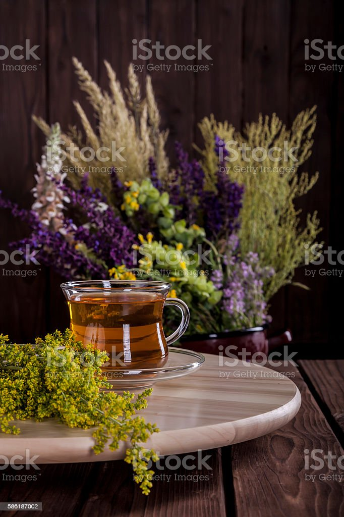 Medicine Herbs on a Wooden Table vertical stock photo