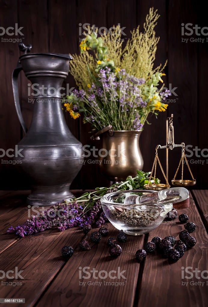 Medicine Herbs, Silver Jug and  Balance stock photo