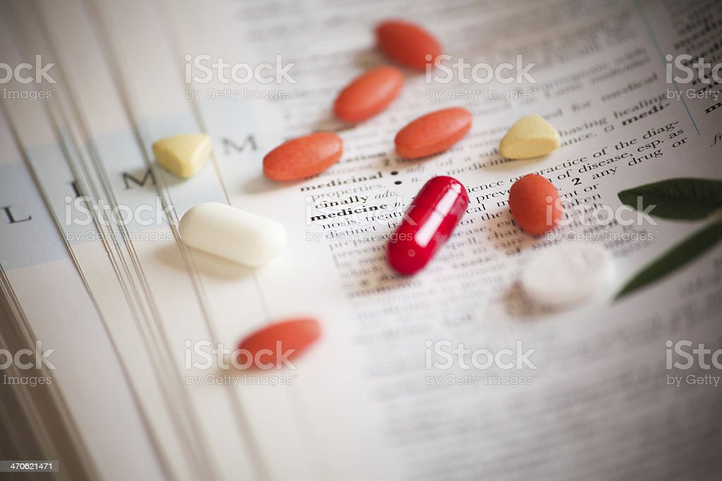 Medicine on books as medical background stock photo