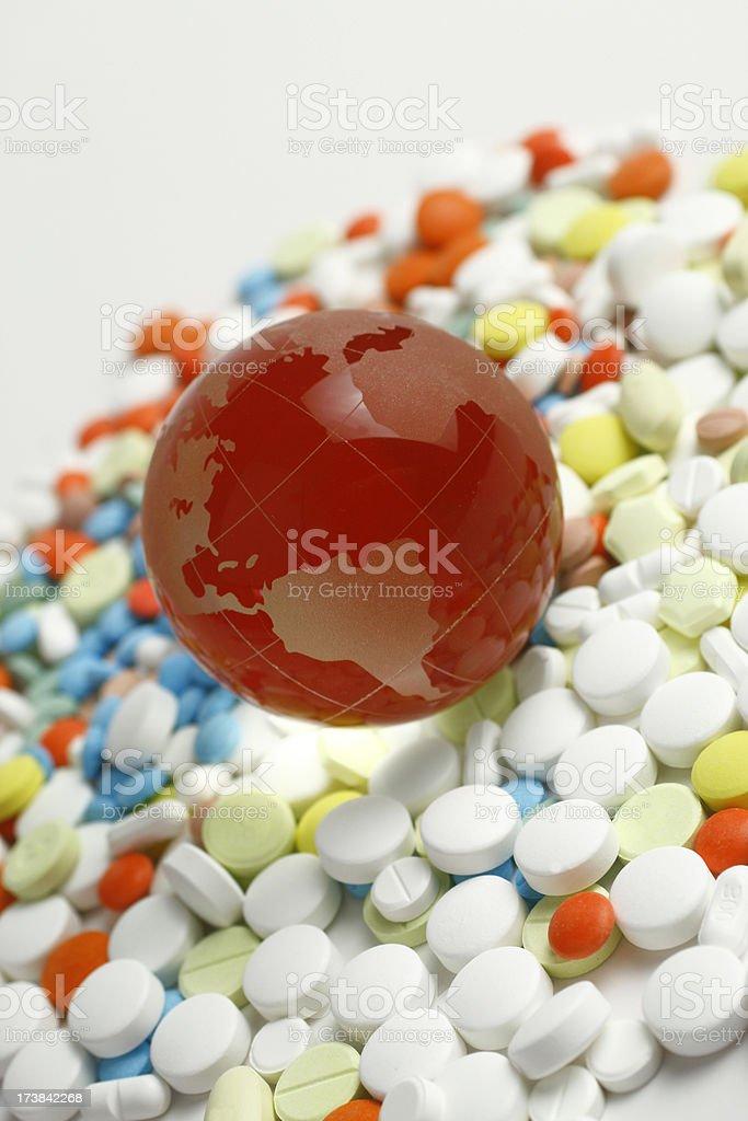 Medicine Pills and Globe royalty-free stock photo