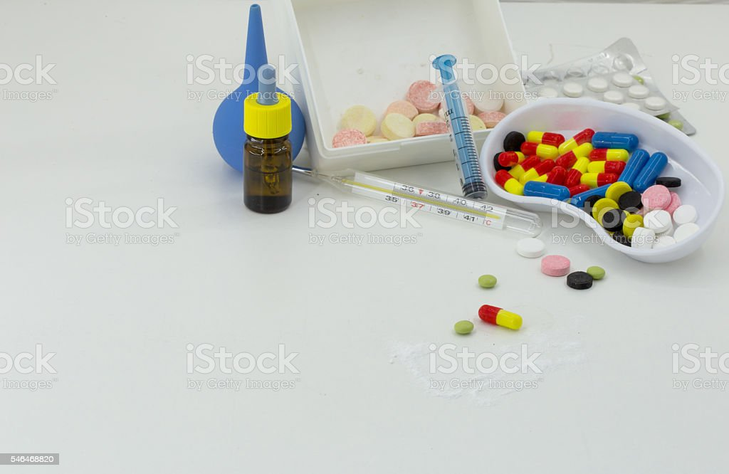 Medicine, pills of different colors on a white background stock photo