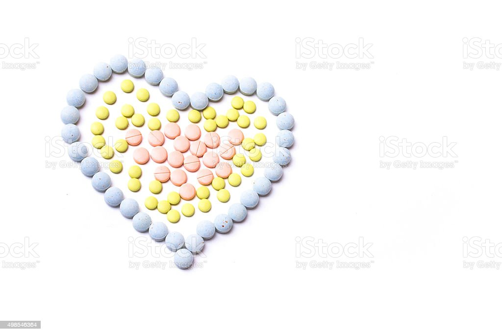 Medicine pills or capsules heart shaped stock photo