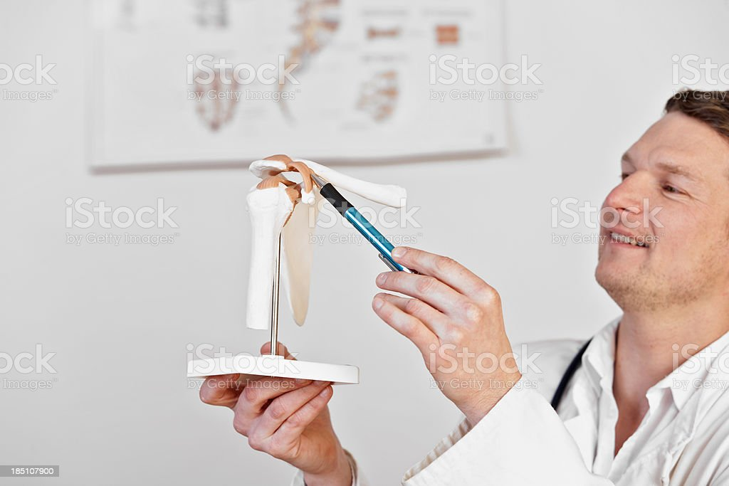 Medicine pointing at shoulder stock photo