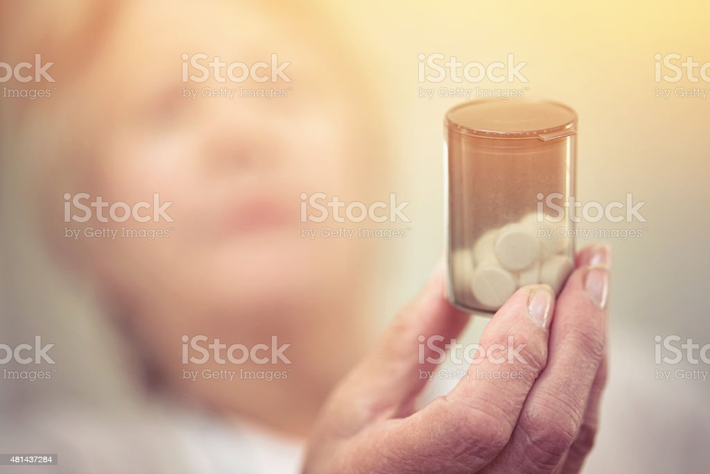 Medicine to manage her chronic health condition stock photo