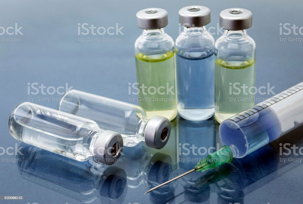 Medicine vials and syringe stock photo