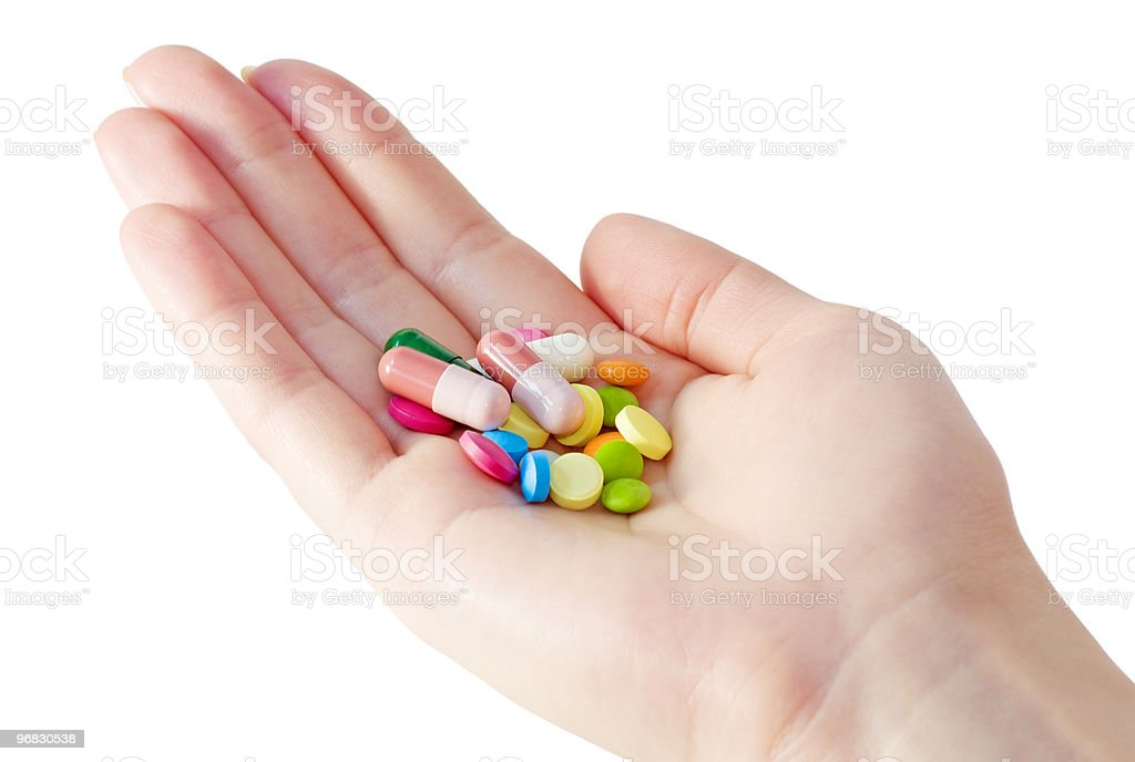 medicines and pills on the palm royalty-free stock photo
