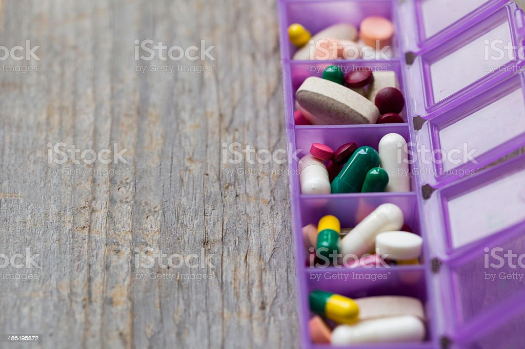 Medicines in a pillbox stock photo