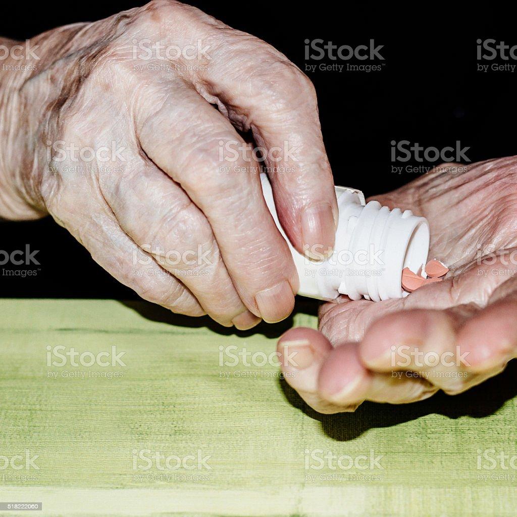 Medicines in hand stock photo