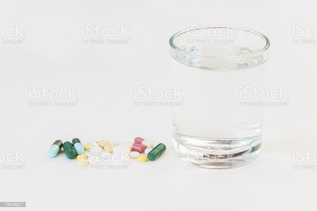 Medicines with glass royalty-free stock photo