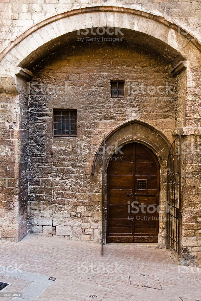 Mediedal stone house with arched door royalty-free stock photo