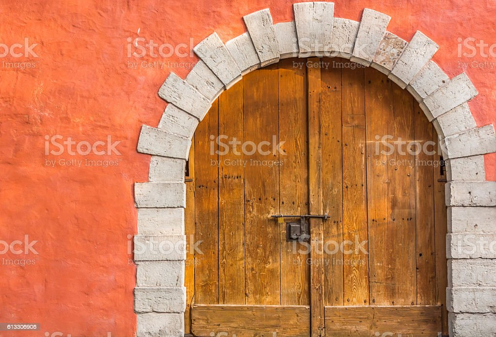Medieval arched wooden door stock photo
