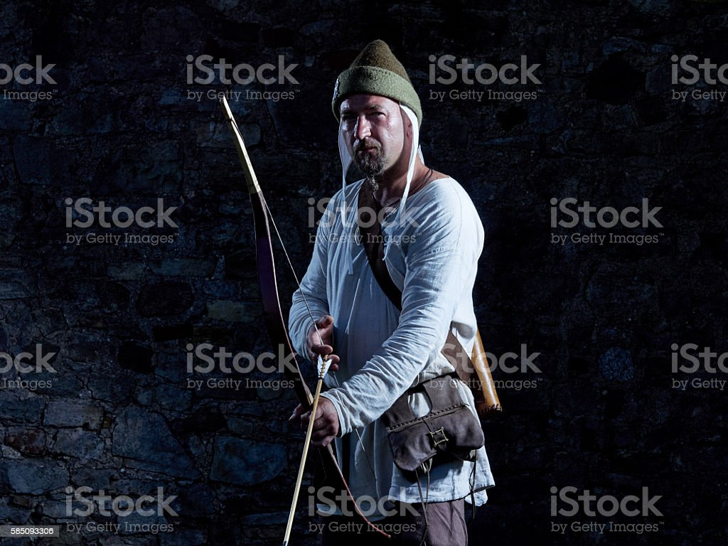 Medieval archer with a bow and arrows stock photo