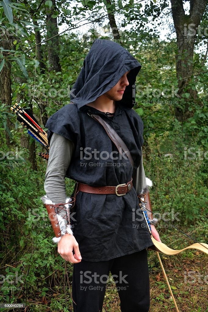 Medieval archer  with coloured arrows stands with bow stock photo