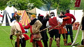 Medieval archery re-enactment. Archers loosing shooting arrows