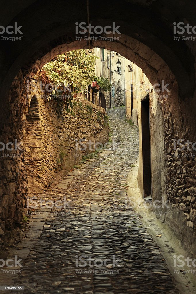medieval archway and narrow alley stock photo