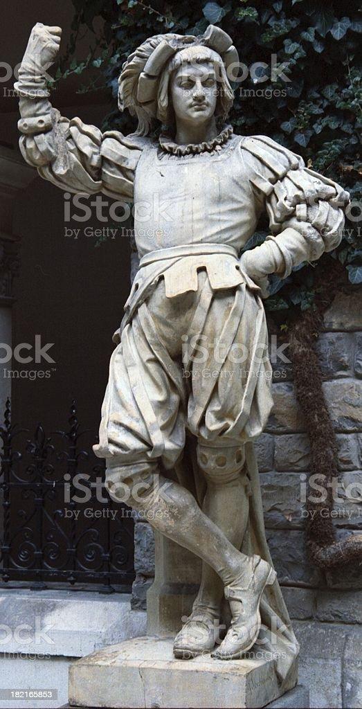 Medieval artist statue stock photo