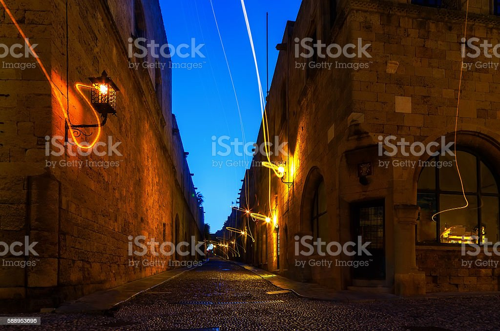 Medieval Avenue of Knights at night,  cobblestone street in Rhodes stock photo