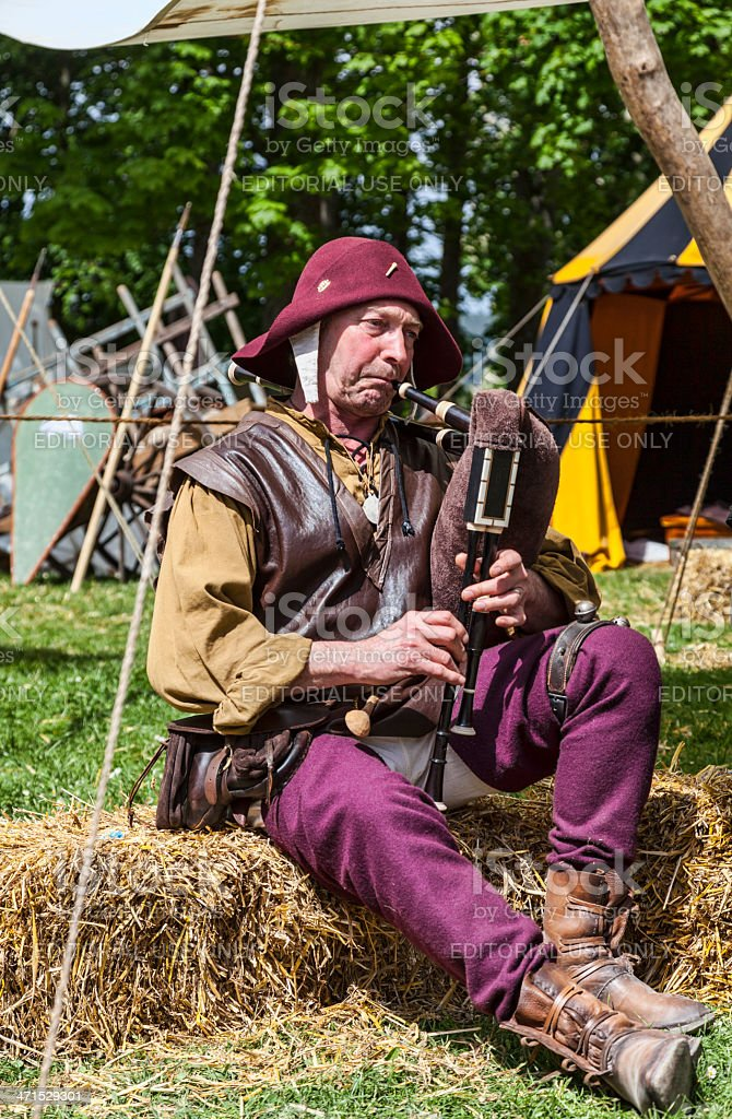 Medieval Bagpiper stock photo