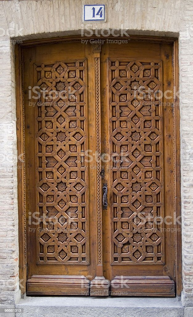 Medieval carved door with number royalty-free stock photo