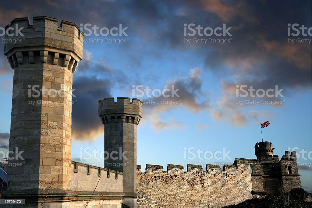 Medieval castle against a blue sky stock photo