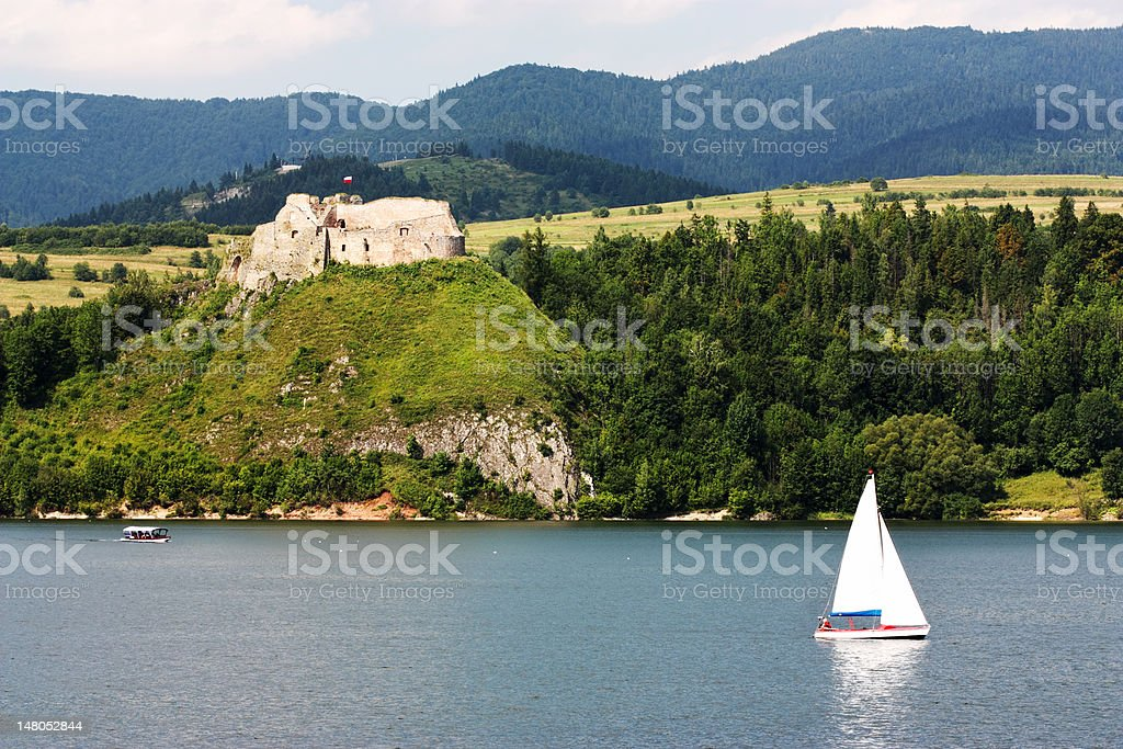Medieval castle and sailboat stock photo