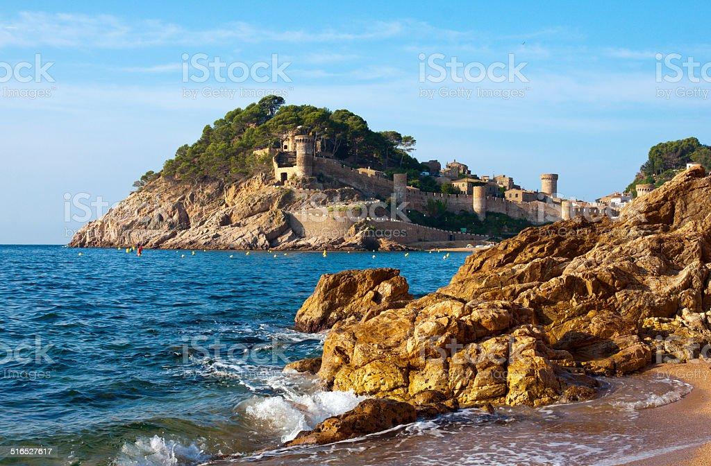 Medieval castle in Tossa de Mar at sunrise, Costa Brava stock photo