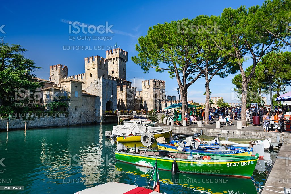 Medieval castle Scaliger in old town Sirmione on lake Lago stock photo