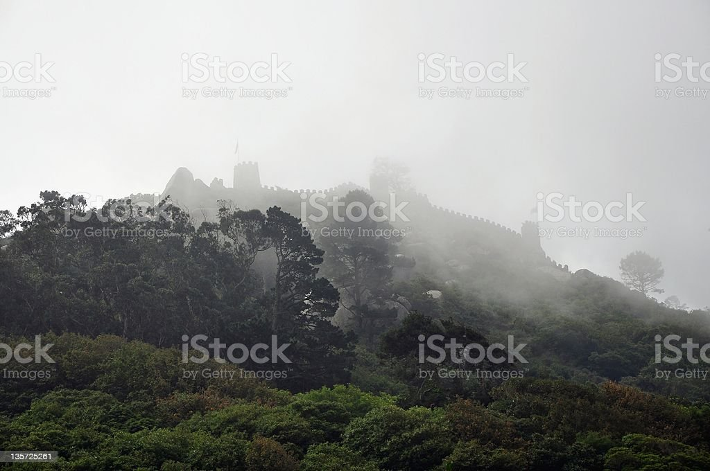 Medieval castle walls in fog at Castelo dos Mouros stock photo