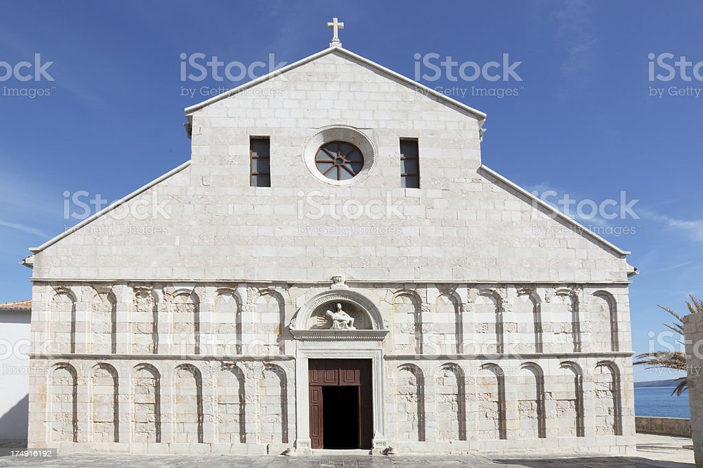 medieval church facade view against blue sky  Rab Croatia royalty-free stock photo