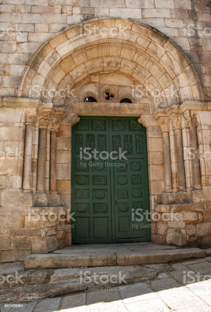 medieval church front door with romanesque architectural style,stone arch and columns in Galicia Spain stock photo