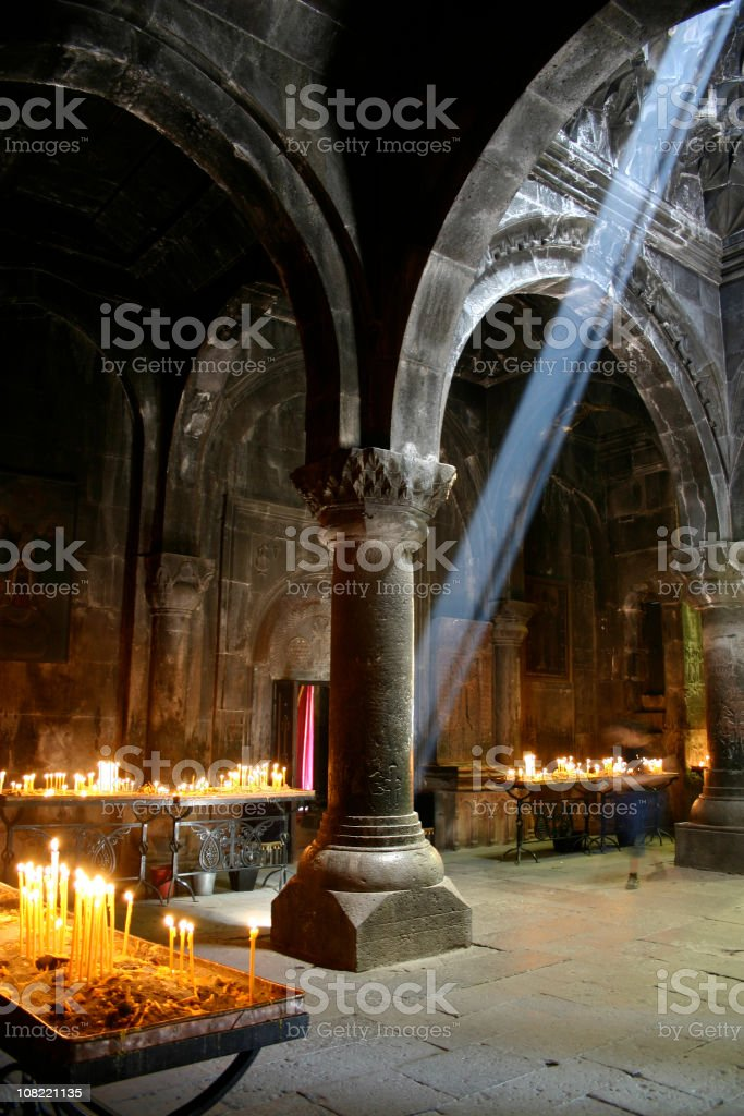 Medieval church in Armenia with Light Shining Through Ceiling stock photo