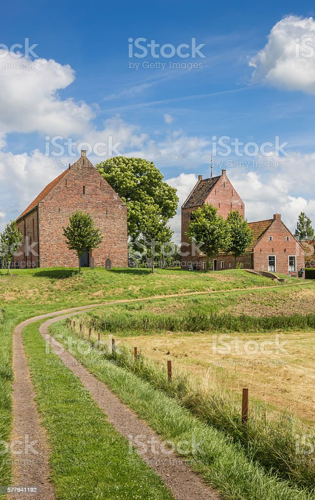 Medieval church on a mound in Groningen village Ezinge stock photo