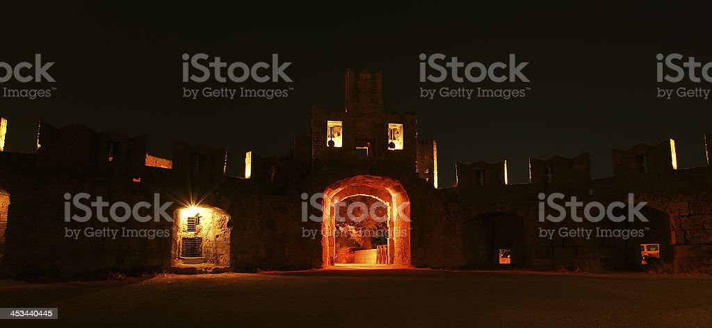 Medieval city walls in Rhodes town (night), Greece royalty-free stock photo