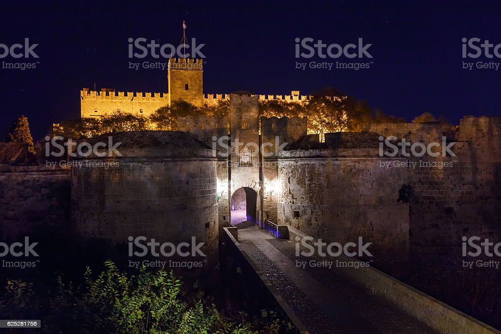 Medieval city walls in Rhodes town night , Greece stock photo