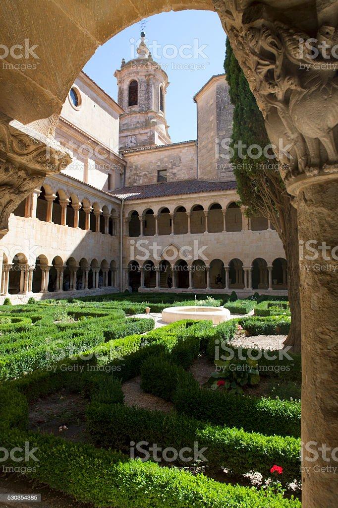 Medieval cloister of Santo Domingo de Silos, Spain. Romanesque style. stock photo